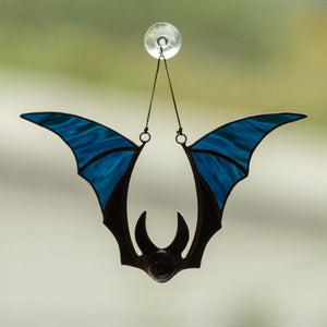 Suncatcher of a stained glass blue-winged bat for Halloween