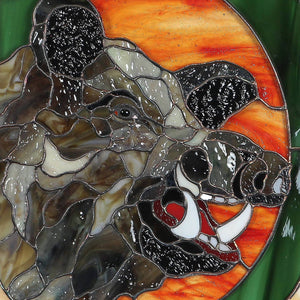 Zoomed stained glass boar's head with its razors panel