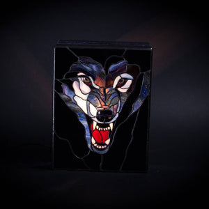 Stained glass wolf showing his fangs lamp