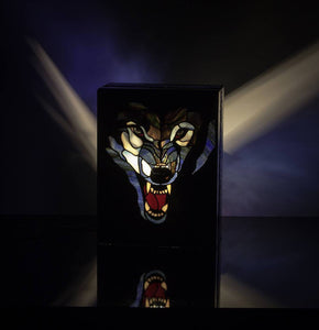 Lit stained glass lamp with angry wolf's head