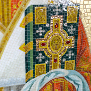 Zoomed stained glass green book with gems in hands of St. Nicolas