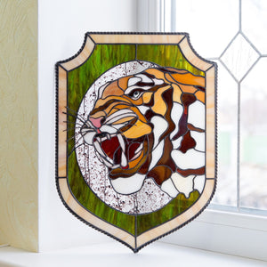 Stained glass panel depicting tiger and his fangs