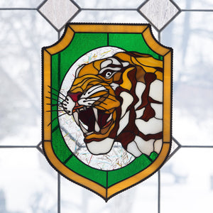 Tiger showing his fangs panel of stained glass
