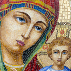 Zoomed stained glass faces of Virgin Mary and Jesus Christ mosaic