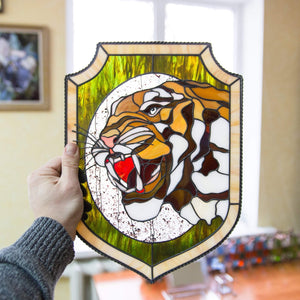 Stained glass tiger's fangs window hanging