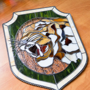 Portrait of tiger showing his fangs panel of stained glass