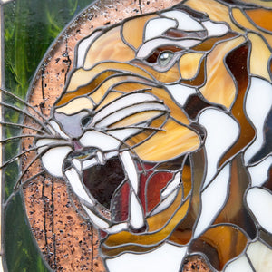 Zoomed stained glass panel of tiger portrait