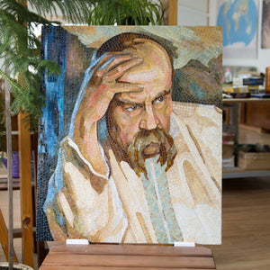 Stained glass mosaic portrait of Yaras Schevchenko touching his forehead with the hand