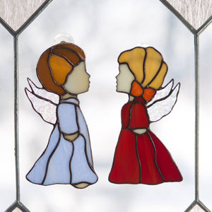 Window hanging of stained glass blue angel boy and red angel girl