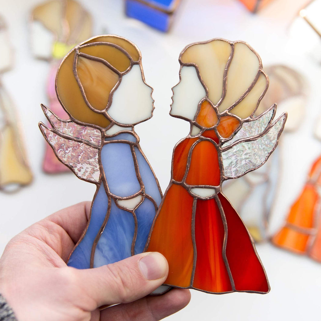 Blue boy angel and red girl angel suncatchers of stained glass