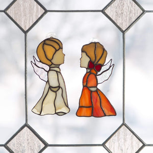 Suncatchers of stained glass beige angel boy and red angel girl