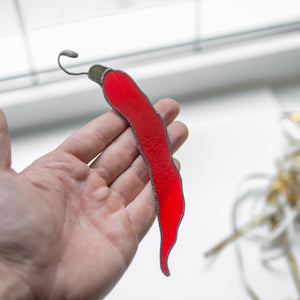 Suncatcher of a stained glass chilli pepper