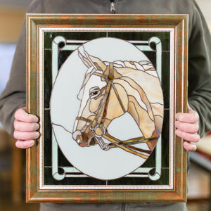 Stained glass horse portrait in an oval panel