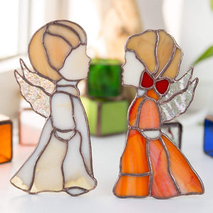 Stained glass beige angel boy and red angel girl window hangings
