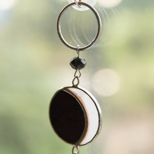 Zoomed stained glass moon phases suncatcher