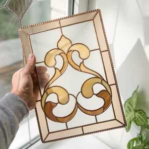 Stained glass panel with beige frame and light brown classic ornamental ringlets