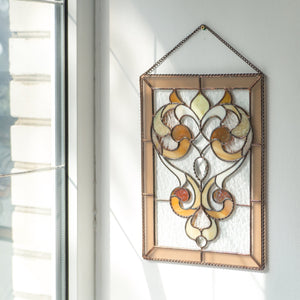 Clear panel with beveled inserts and beige ringlets of stained glass