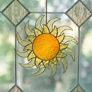 Window hanging of a stained glass shining sun