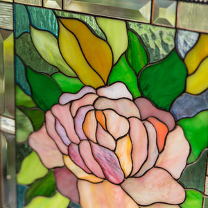 Zoomed stained glass panel depicting pink peony