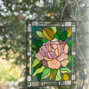 Stained glass window hanging depicting pink peony with leaves