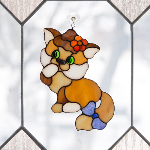 Stained glass kitty with the bow on the tail window hanging