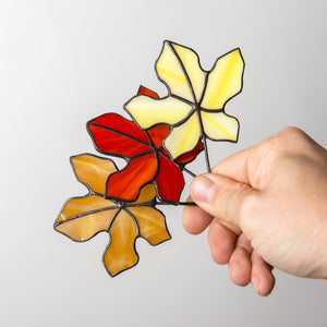 Stained glass three maple leaves of yellow, red, and brown colours suncatchers