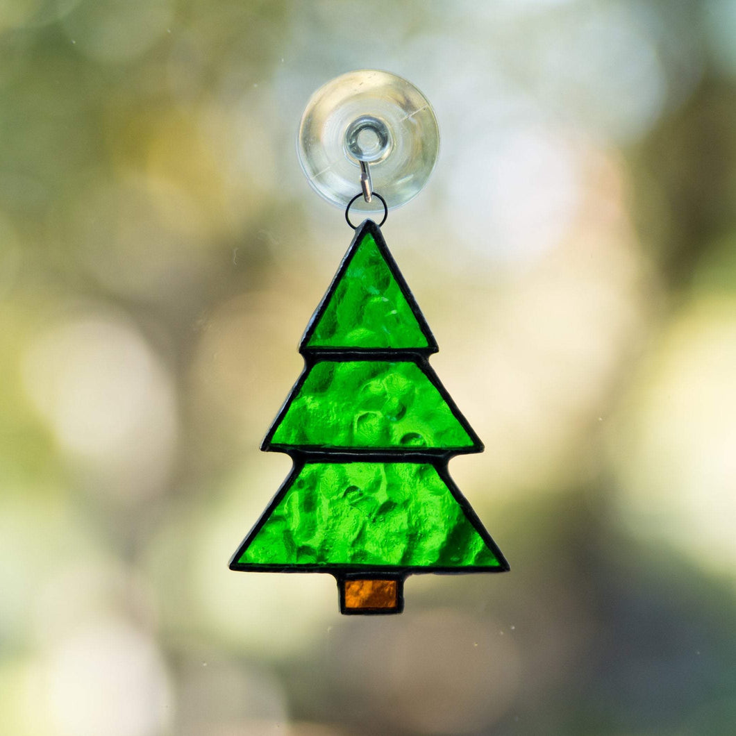 Stained glass suncatcher of a Christmas tree