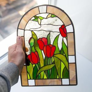 Stained glass panel depicting red tulips