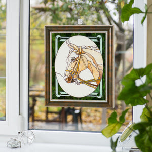 Stained glass horse panel in a frame as a window hanging