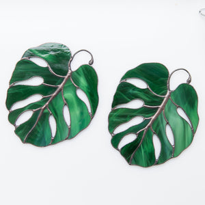 Two stained glass monstera leaves suncatchers