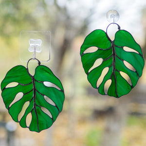 Two stained glass monstera leaves window hangings