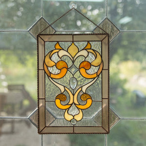 Stained glass clear panel with saturated beige ringlets