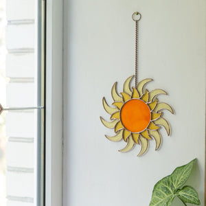 Stained glass shining sun as a wall hanging