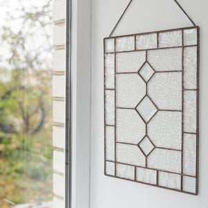 Stained glass panel with beveled inserts as a wall hanging