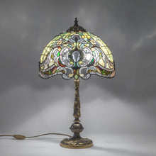 Load image into Gallery viewer, Lit stained glass green Tiffany lampshade with bronze base with engraving