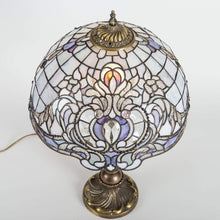 Load image into Gallery viewer, Top view of stained glass Tiffany lamp with purple markings