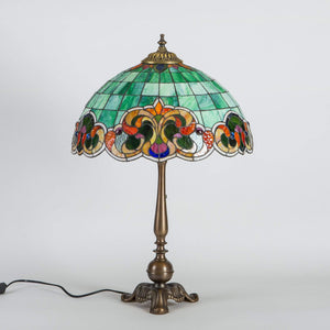 Stained glass green lamp in Tiffany style with colourful markings