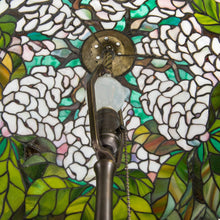 Load image into Gallery viewer, Stained glass Tiffany lamp of green leaves and white flowers from the inside
