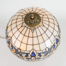 Load image into Gallery viewer, Top view of stained glass lamp shade of beige colours with blue inserts