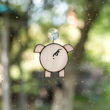 Load image into Gallery viewer, Suncatcher of a stained glass pig looking through the window
