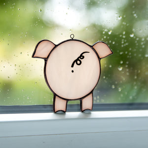 Stained glass looking through the window pig suncatcher