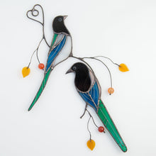 Load image into Gallery viewer, A pair of stained glass magpies sitting on the branch window hanging