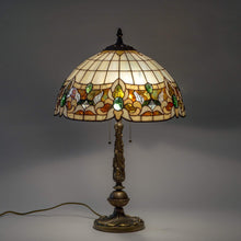 Load image into Gallery viewer, Lit stained glass Tiffany lamp in beige colour with green inserts