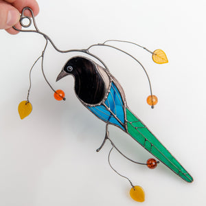 Stained glass suncatcher of a magpie back view