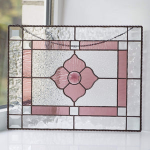 Pink beveled window hanging of stained glass