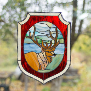 Stained glass deer in the forest environment panel with red and beige frames