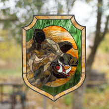 Load image into Gallery viewer, Stained glass panel of a boar with its razors on green and orange background