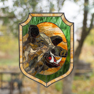 Stained glass panel of a boar with its razors on green and orange background
