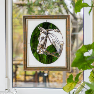 Stained glass horse portrait in a green oval and white background framed panel