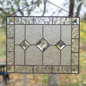 Stained glass clear panel with beveled inserts